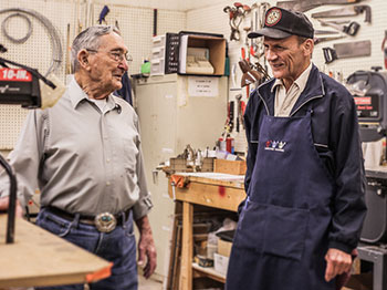 howard and dolan make conversation in the arboretum woodshop