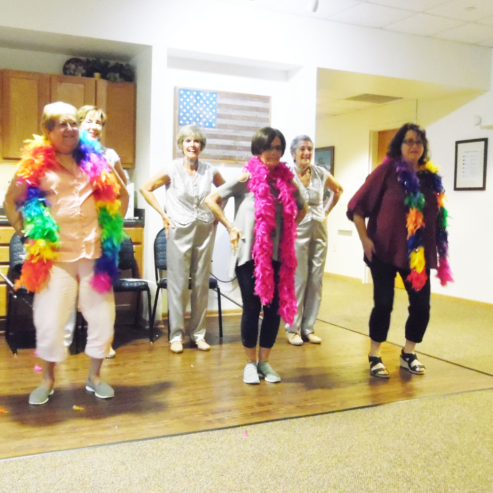 Residents from Trinity Courtyard senior living community in Omaha, Nebraska watch a performance by the Dancing Grannies dance group.