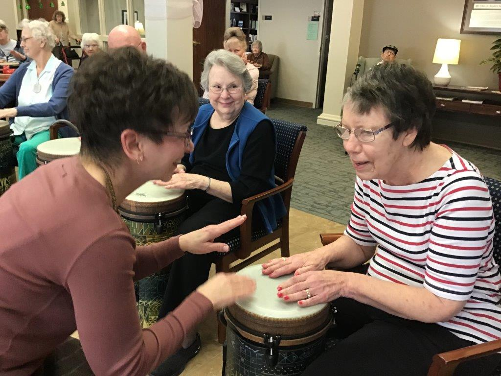 Residents participate in social drumming