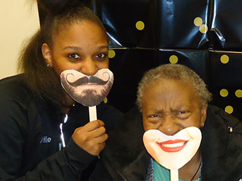 Participants and staff at Immanuel Pathways in Omaha celebrate World Smile Day