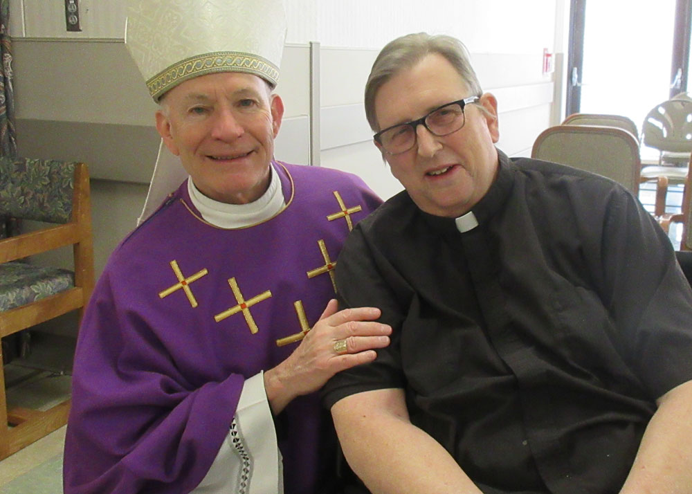 archbishop visits with a resident