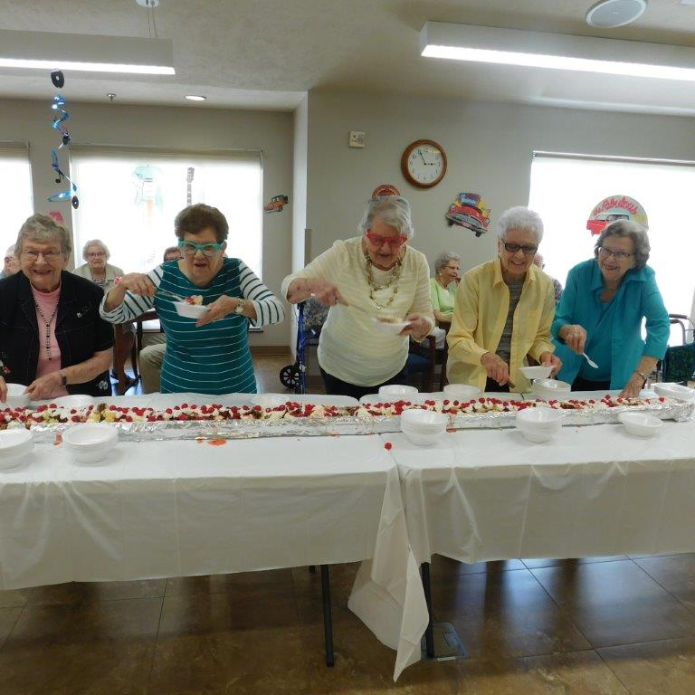 Residents at Clark Jeary senior living community dig into a gutter banana split!