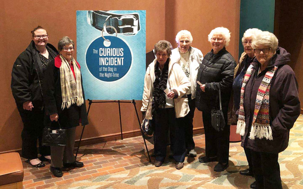 Residents from Trinity Village attend a play at the Omaha Community Playhouse