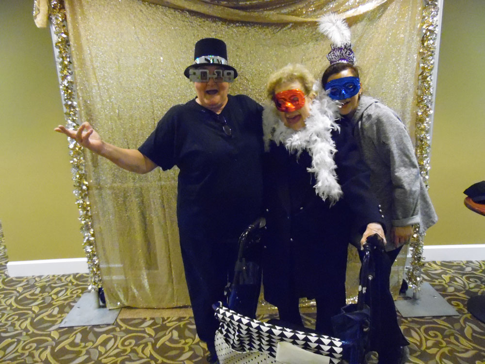 Residents from Pacific Springs Village senior living community pose for a photo during their masquerade ball