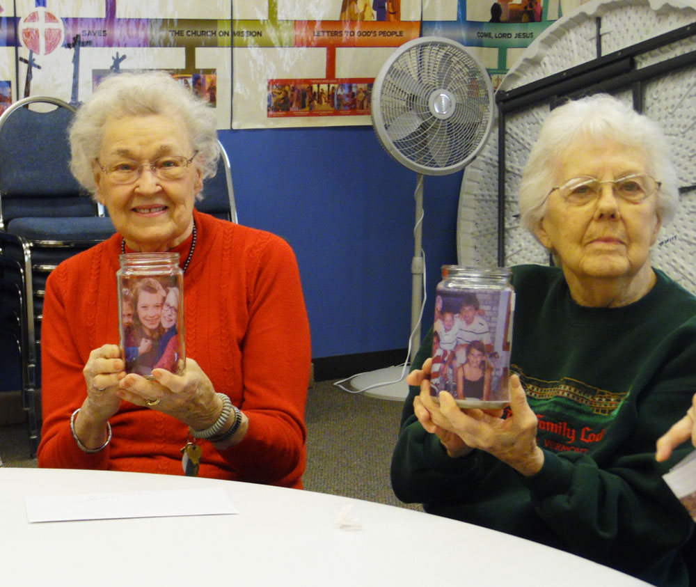 Residents at Trinity Village celebrate Valentine's Day by making photo luminaries.