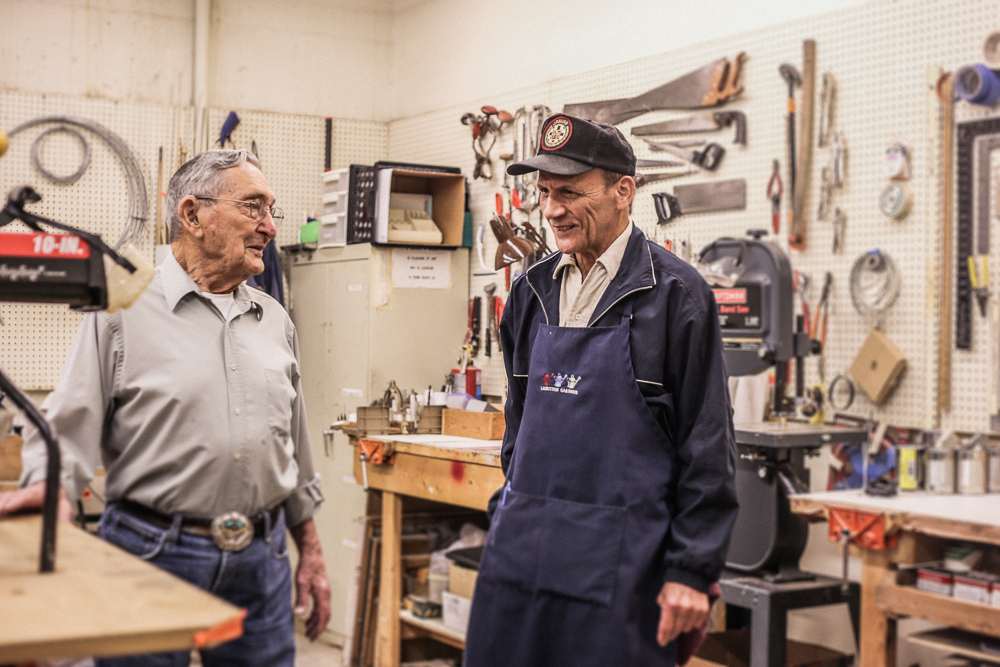 howard and dolan make conversation in the arboretums woodshop