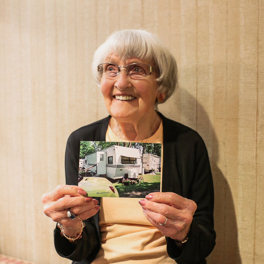 Pauline Himes, resident at Lakeside Village retirement community, poses with a photo of her camper.