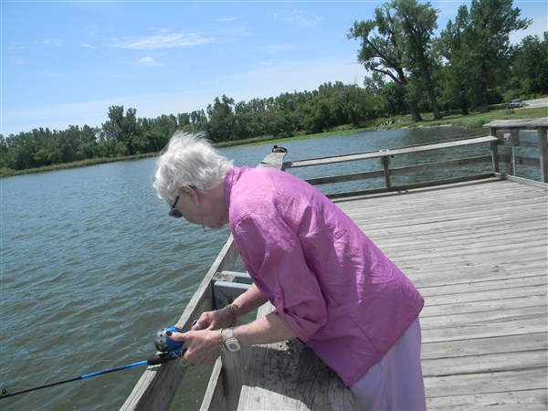 A participant from Immanuel Pathways in Southwest Iowa reels in a catch during a fishing excursion