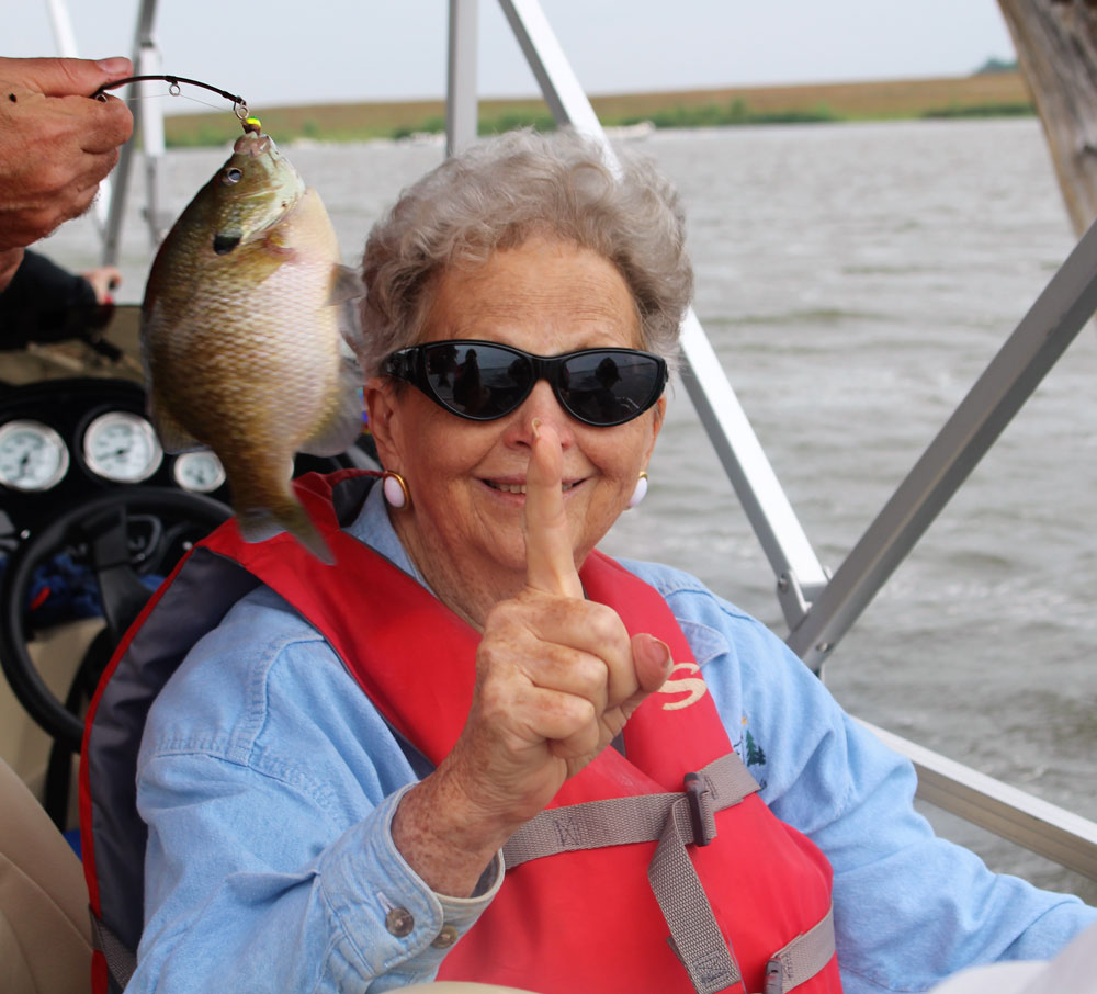 Residents at Clark Jeary senior living community in Lincoln, Nebraska take part in a fishing adventure with Live Well. Go Fish.